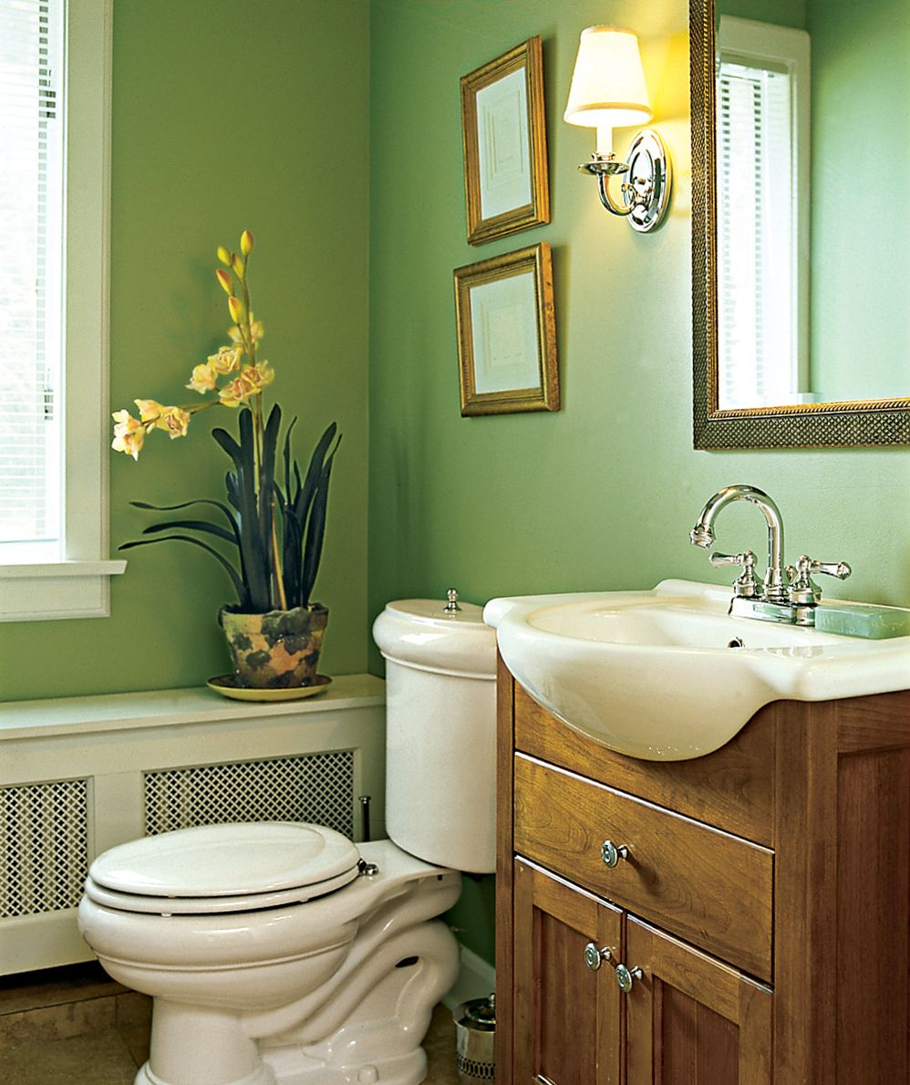 <p><strong>New Traditional</strong><br> A bulbous toilet and sink give this powder room vintage charm. The dresserlike vanity and radiator cover-as-window seat add to the half bath's old-fashioned appeal.</p>