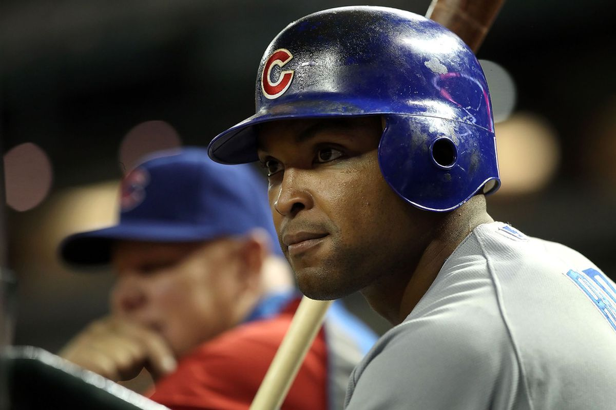 Marlon Byrd and manager Mike Quade of the Chicago Cubs watch from the dugout during the Major League Baseball game against the Arizona Diamondbacks at Chase Field on April 28, 2011 in Phoenix, Arizona.  (Photo by Christian Petersen/Getty Images)