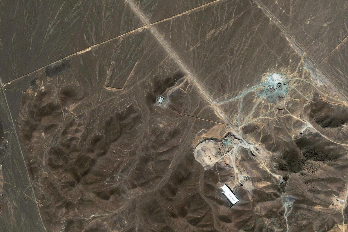 FILE -A file satellite image taken Sunday Sept. 27, 2009, provided by DigitalGlobe, shows a suspected nuclear enrichment facility under construction inside a mountain located north of Qom, Iran. Critical nuclear talks between Iran and world powers could b