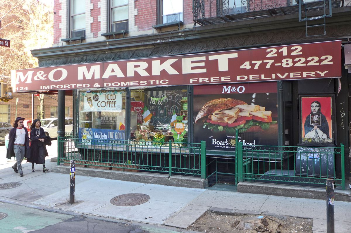 A deli with a dark red awning.