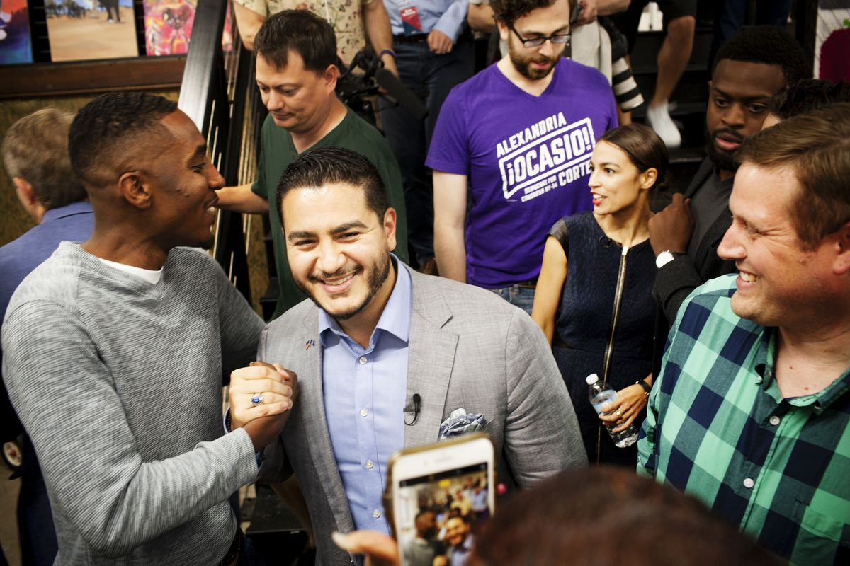 Alexandria Ocasio-Cortez and then gubernatorial candidate Abdul El-Sayed greet supporters in Flint, Michigan on July 28, 2018. El-Sayed campaigned on progressive issues such as Medicare-for-all, clean water for Flint, and immigration reform.