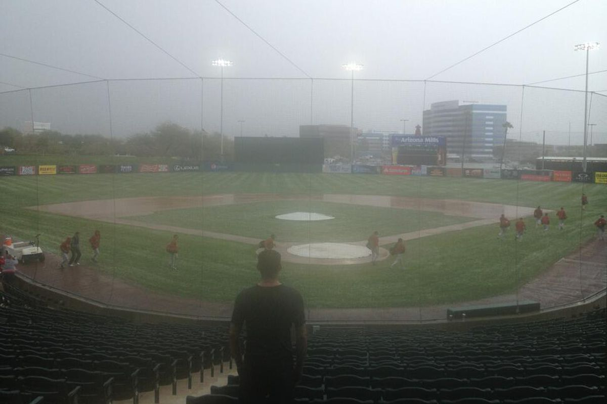 Dbacks players running from the hail