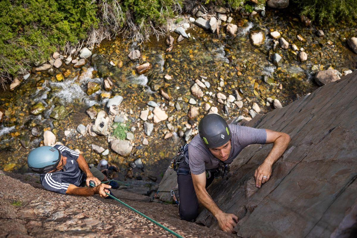 Quino Gonzalez, a guide and instructor for Utah Mountain Adventures, left, supervises while Steve Mullalley climbs during a trad climbing clinic in Big Cottonwood Canyon on Saturday, July 31, 2021.