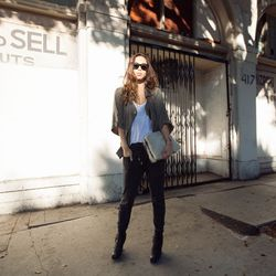"""<a href=""""http://www.fashiontoast.com/2013/11/off-duty.html""""target=""""_blank"""">Fashiontoast</a>'s Rumi Neely in Isabel Marant for H&M tank ($29.99) and sweatpants ($34.95)."""