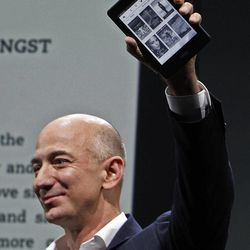 Jeff Bezos, CEO and founder of Amazon, holds the Kindle Paperwhite at the introduction of the new Amazon Kindle Fire HD and Paperwhite devices in Santa Monica, Calif., Thursday, Sept. 6, 2012.