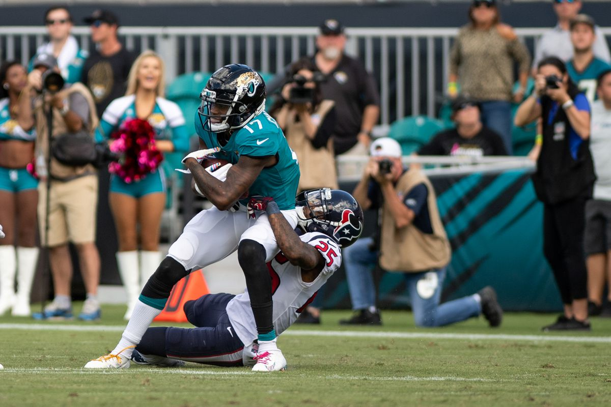 Jacksonville Jaguars wide receiver DJ Chark is tackled by Houston Texans safety Kareem Jackson during the fourth quarter at TIAA Bank Field.