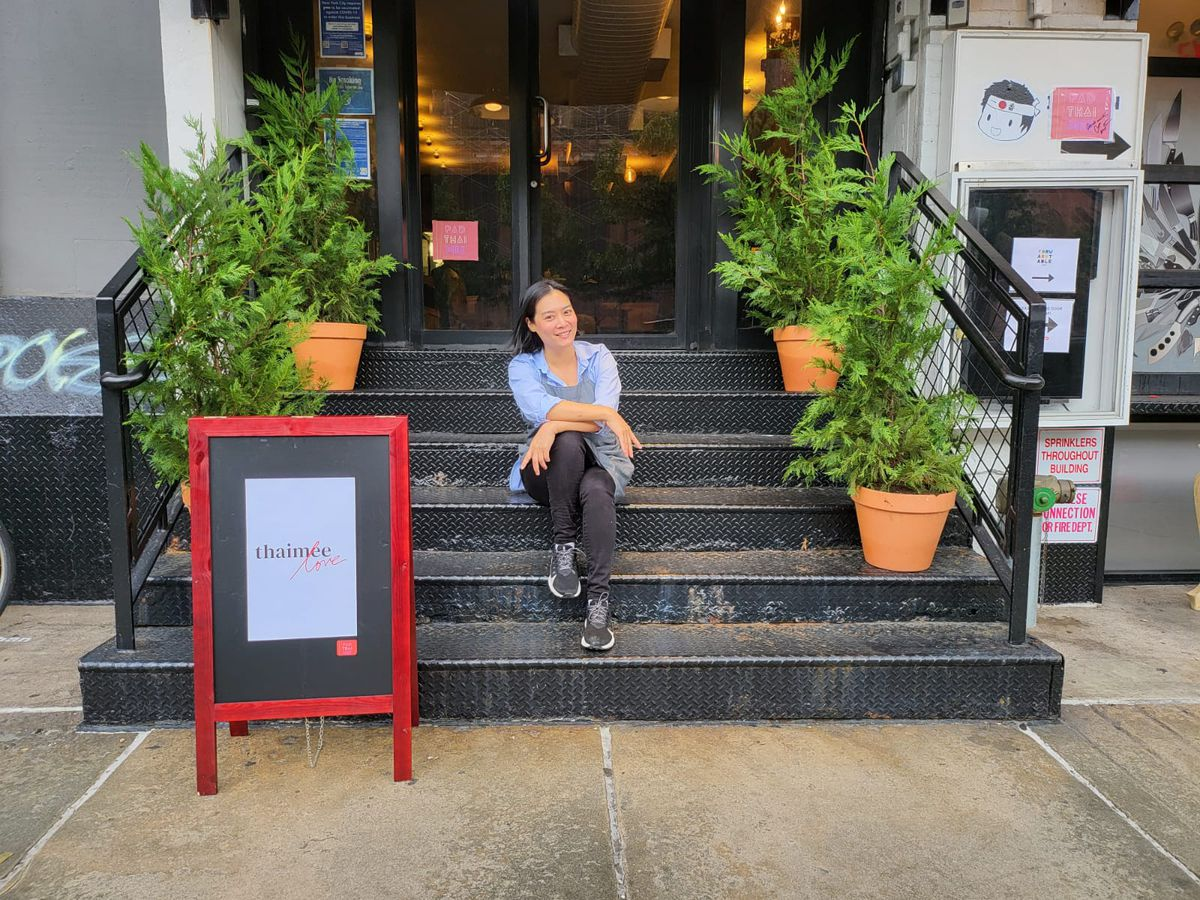 Chef Hong Thaimee sits on the steps outside of her newly opened restaurant Thaimee Love in the West Village.