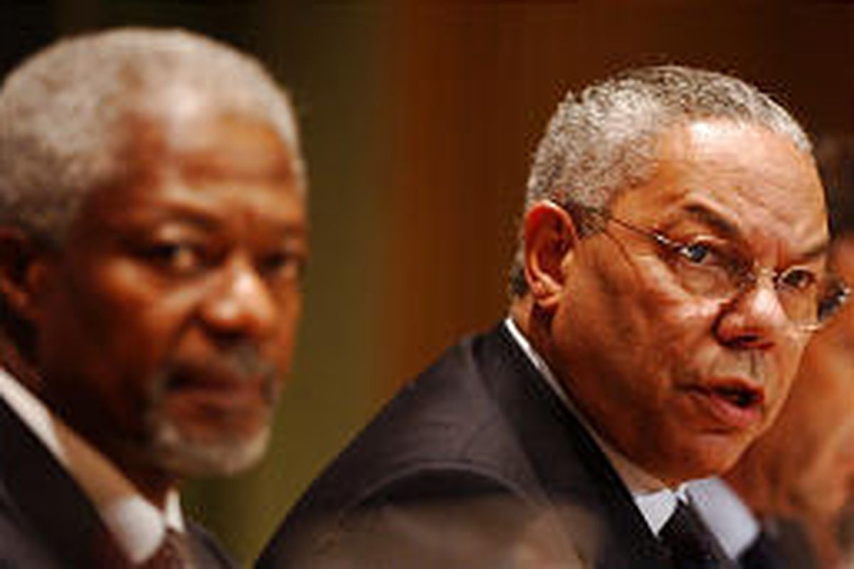 U.N. Secretary General Kofi Annan, left, and U.S. Secretary of State Colin Powell meet with other leaders.