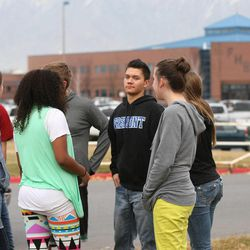 Fremont High School students are evacuated from the school after reports of a student with a gun were made in Ogden Monday, Dec. 1, 2014.