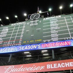 """1:33 a.m.: Right after Baker scored the winning run, the first words of """"Go Cubs Go"""" on the message board"""
