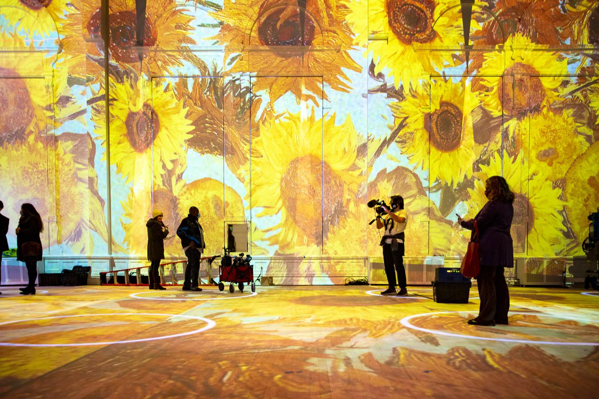 Chicago media attends a press preview of the Immersive Van Gogh exhibition in the historic Germania Club Building on Thursday.