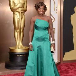Viola Davis wore a jewel-toned green Escada gown. Escada has had a long-time boutique at the Forum Shops at Caesars. She also wore Charlotte Olympia shoes, a Jimmy Choo clutch and Lorraine Schwartz earrings and cuffs. Find Jimmy Choo at the Grand Canal Sh
