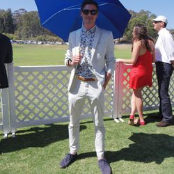 This gent stayed cool under one of the Royal Salute parasols given out to guests.