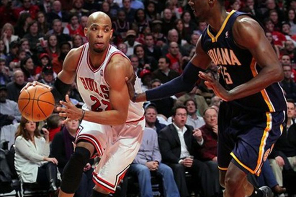 Mar 5, 2012; Chicago, IL, USA; Chicago Bulls forward Taj Gibson (22) drives past Indiana Pacers center Roy Hibbert (55) during the second half at the United Center. The Bulls won 92-72. Mandatory Credit: Dennis Wierzbicki-US PRESSWIRE
