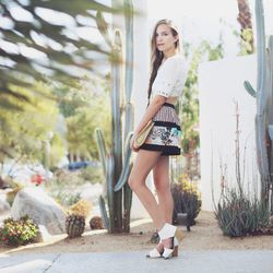 """Bethany of <a href=""""http://outofabook.blogspot.com/"""">Snake's Nest</a> in a BCBG top, shorts and sunglasses and a vintage bag."""
