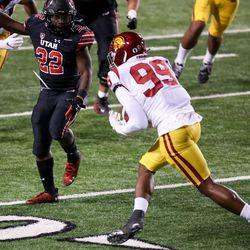 USC Trojans linebacker Drake Jackson (99) intercepts a pass intended for Utah Utes running back Ty Jordan (22) at Rice-Eccles Stadium in Salt Lake City on Saturday, Nov. 21, 2020.