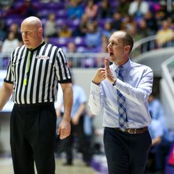 Dixie's head coach Tyler Roberts calls out to his team during the 4A boys championship basketball game against Sky View at the Dee Events Center in Ogden on Saturday, Feb. 29, 2020.