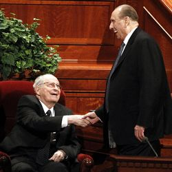 Robert D. Hales says hello to President Thomas S. Monson as Monson arrives for the afternoon session of the 182nd Annual General Conference for The Church of Jesus Christ of Latter-day Saints at the LDS Conference Center in Salt Lake City on Saturday, March 31, 2012.