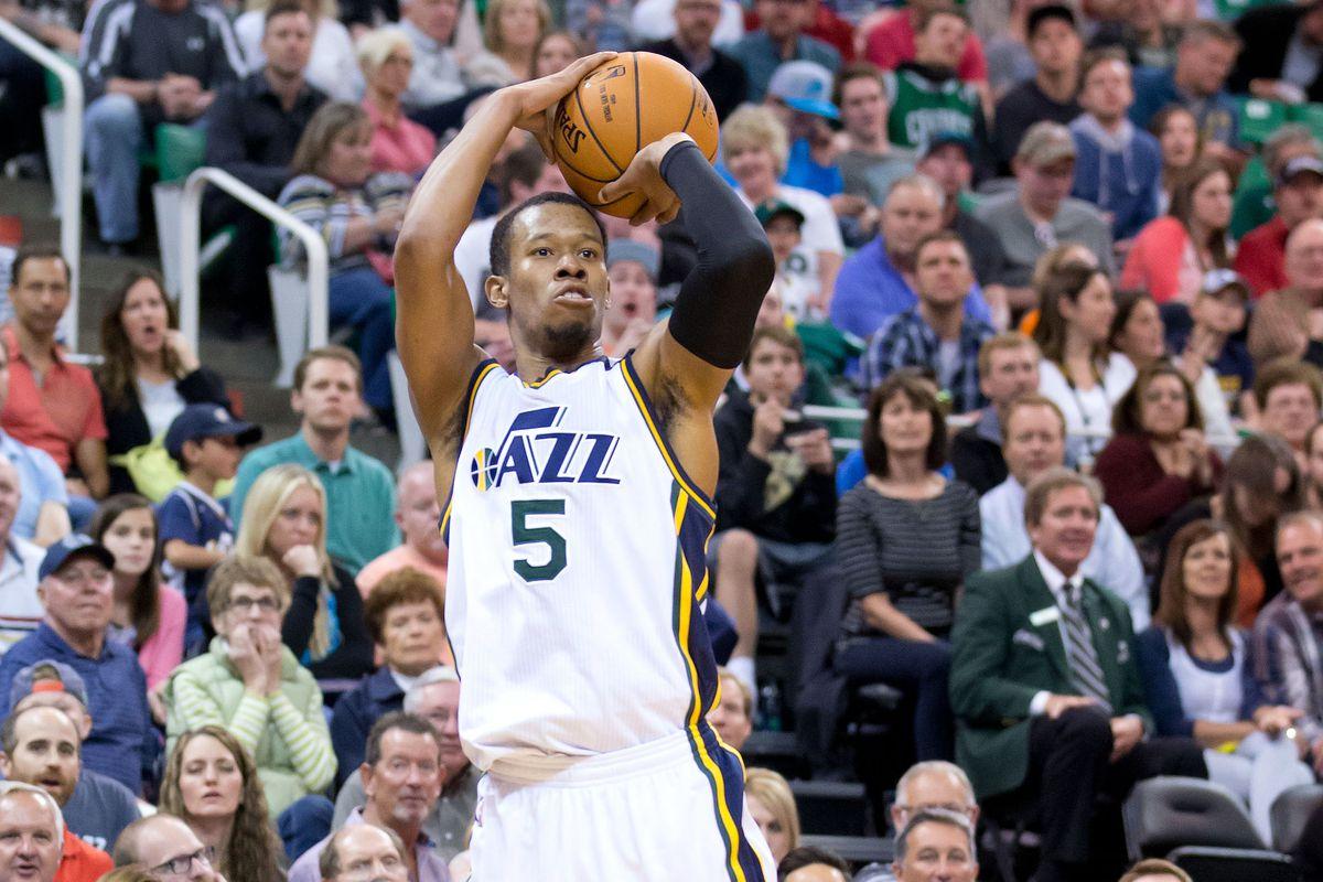 Mar 28, 2015; Salt Lake City, UT, USA; Utah Jazz guard Rodney Hood (5) shoots the ball during the second half against the Oklahoma City Thunder at EnergySolutions Arena. The Jazz won 94-89.