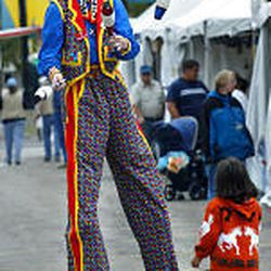 """Clown """"Joe Cool"""" entertains a fan at the Utah State Fair two years ago. While the fair's popularity has vacillated throughout the years, it still draws big crowds."""