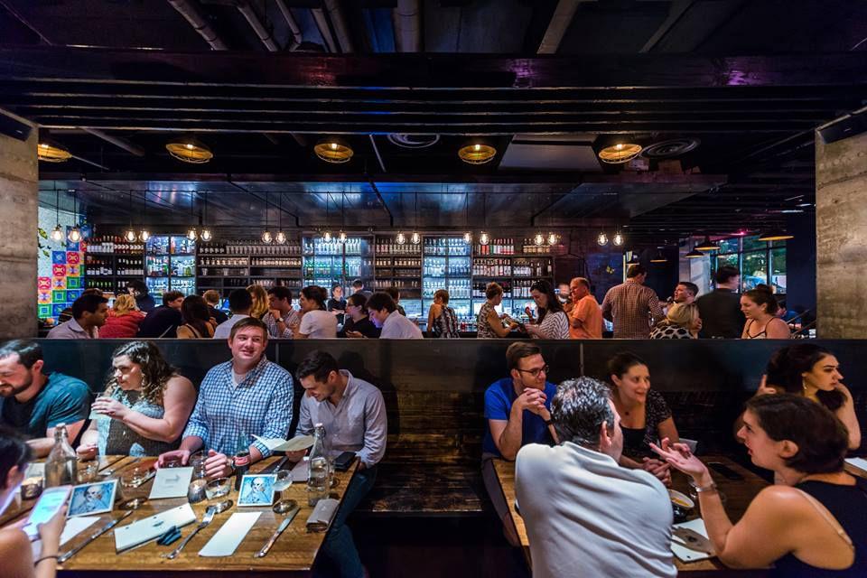 A crowded dining room inside Espita Mezcaleria