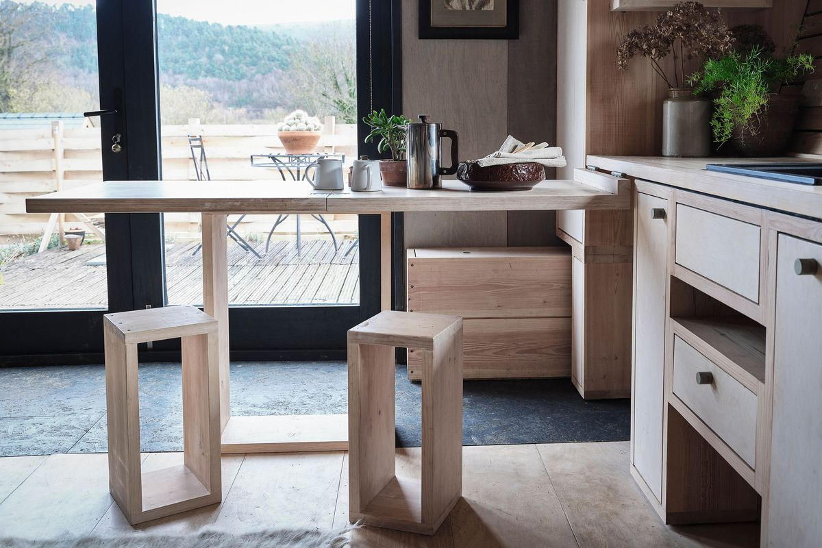 A breakfast bar that can be easily stored into the kitchen cabinet.