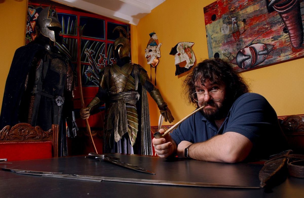 Peter Jackson, New Zealand director of The Lord of the Rings, sitting in a yellow room with elvan armor in the background