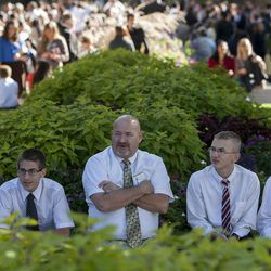 Joe Richins, center, sits with a group of young men, from the left, Tyler Caldwell, Justin Richens, Teigan Tolman and Coire Vosika from Idaho wait for the Priesthood session during the Saturday afternoon session of the 183rd Semiannual General Conference for the Church of Jesus Christ of Latter-day Saints Saturday, Oct. 5, 2013 inside the Conference Center.