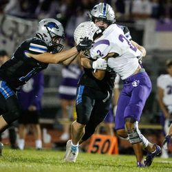 Tooele's Gabe Medina (2) gets pressured by Stansbury's defense during a high school football gameat Stansbury High School in Stansbury Park on Friday, Sept. 17, 2021.