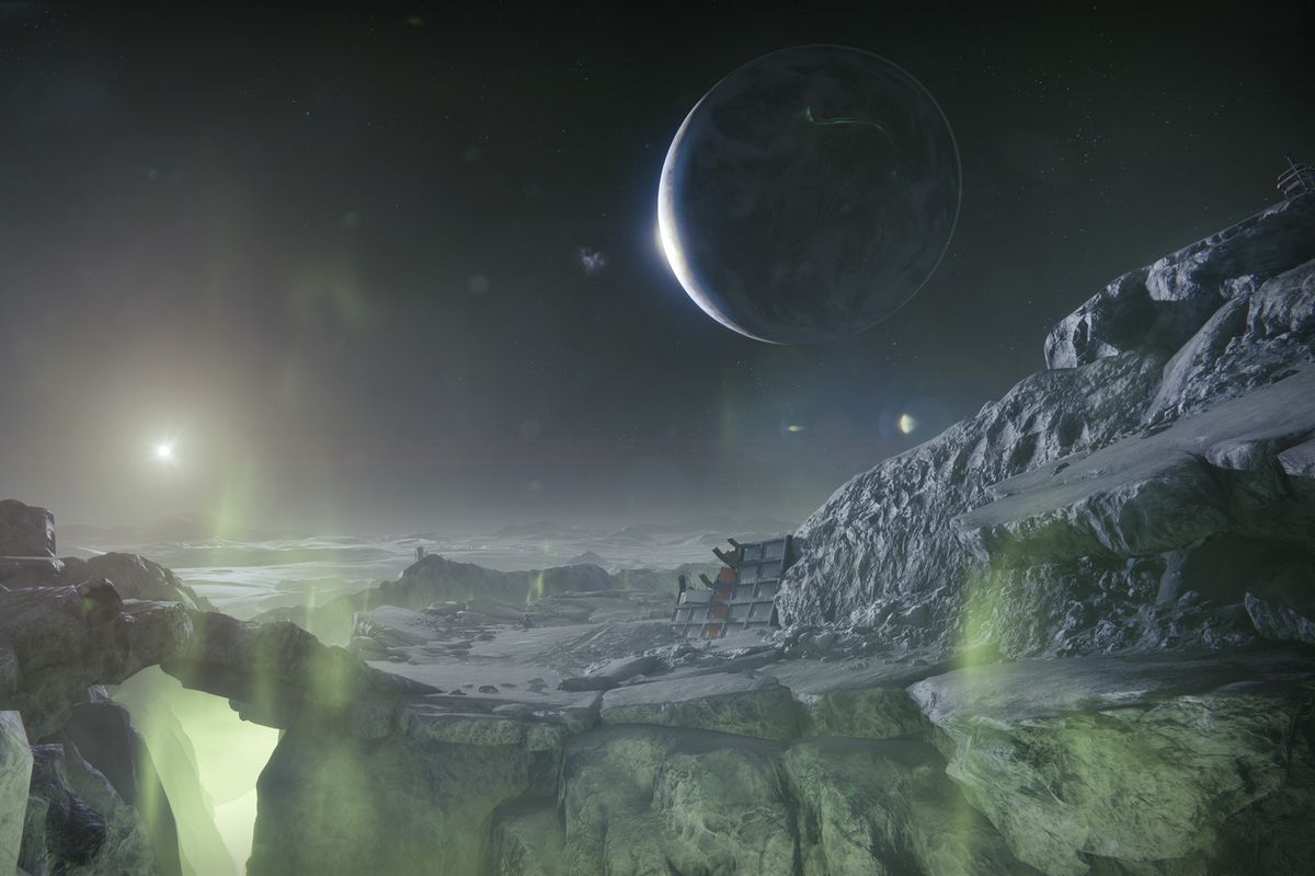 A screenshot of the Moon's surface, with Earth visible in the background, from Destiny 2: Shadowkeep