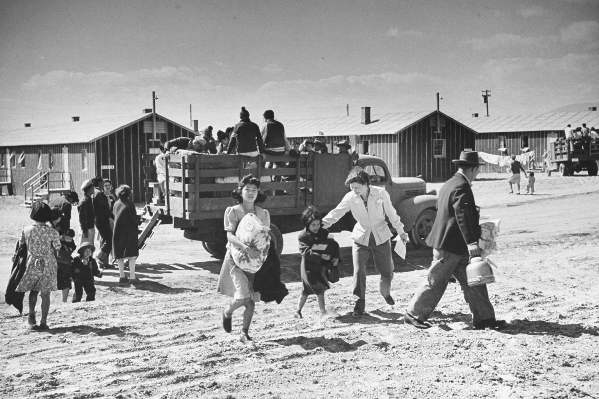 Japanese American families arriving at Heart Mountain Relocation Camp in northwestWyoming on January 01, 1942. The camp was one of ten concentration camps used for theinternment of Japanese Americans.