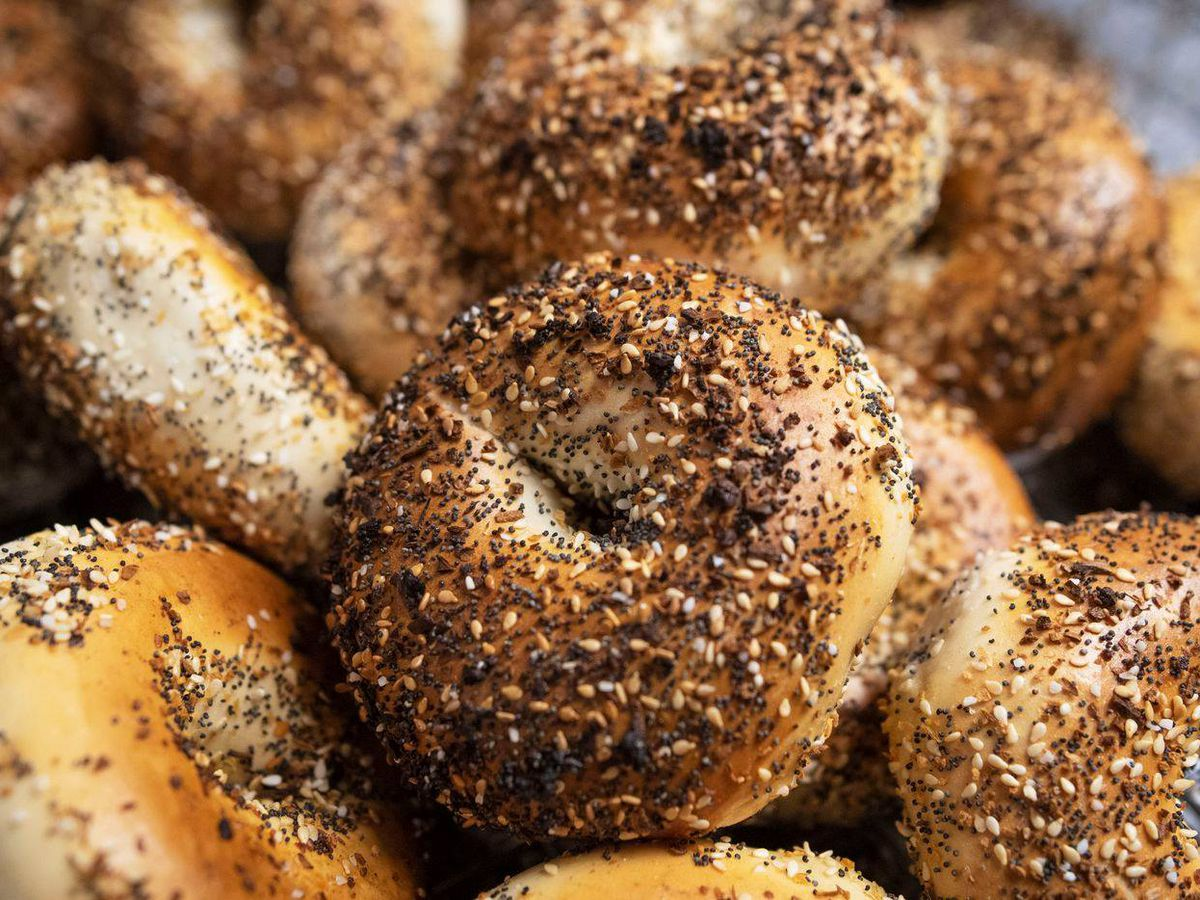 Everything bagels piled on top of each other in a jumble