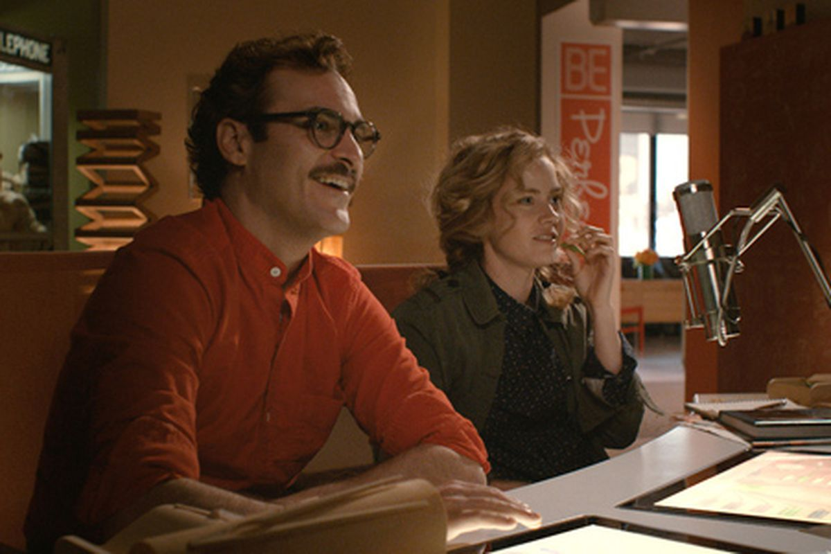 """Joaquin Phoenix and Amy Adams in Spike Jonze's film, Her. Still via <a href=""""http://www.herthemovie.com/#/post/70328157126/her-now-playing-in-select-theaters-starts"""">Warner Bros</a>."""