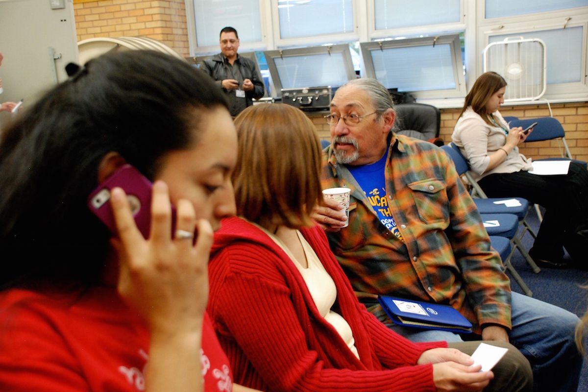 Padres & Jovenes Unidos co-director Ricardo Martinez, right, at Abraham Lincoln High School on Wednesday.