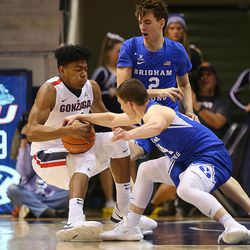 Gonzaga Bulldogs forward Rui Hachimura (21) falls to the floor as Brigham Young Cougars guard McKay Cannon (24) reaches for the ball as BYU and Gonzaga play in an NCAA basketball game in the Marriott Center in Provo on Saturday, Feb. 24, 2018.