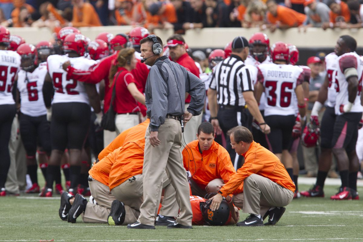 Sept 15, 2012; Stillwater OK, USA; Oklahoma State Cowboys quarterback Wes Lunt (11) is down after a tackle during the first quarter against the Louisiana-Lafayette Ragin Cajuns at Boone Pickens Stadium.  Mandatory Credit: Richard Rowe-US PRESSWIRE