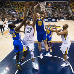 Utah Jazz center Rudy Gobert #27 attempts a shot under Golden State Warriors center Zaza Pachulia during game four of the Western Conference Semifinal at Vivant Smart Home Arena in Salt Lake City on Monday, May 8, 2017.
