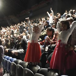 Primary children wave to President Russell M. Nelson of The Church of Jesus Christ of Latter-day Saints during a devotional at Movistar Arena in Bogota, Colombia, on Sunday, Aug. 25, 2019.