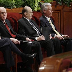 Presidents Thomas S. Monson, Henry Eyring and Dieter Uchtdorf smile at attendees prior to the 182nd Annual General Conference for The Church of Jesus Christ of Latter-day Saints in Salt Lake City  Saturday, March 31, 2012.