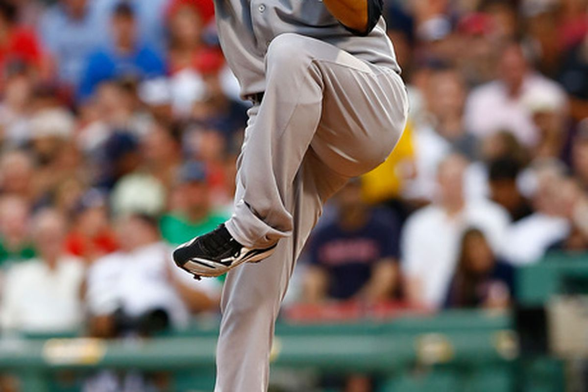 BOSTON, MA - JULY 06:  Hiroki Kuroda #18 of the New York Yankees pitches against the Boston Red Sox during the game on July 6, 2012 at Fenway Park in Boston, Massachusetts.  (Photo by Jared Wickerham/Getty Images)