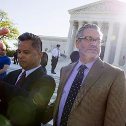 Plaintiffs Johno Espejo, left, and his husband Matthew Mansell, of Franklin, Tenn., prepare to enter the Supreme Court in Washington, Tuesday, April 28, 2015. The Supreme Court heard historic arguments in cases that could make same-sex marriage the law of the land.