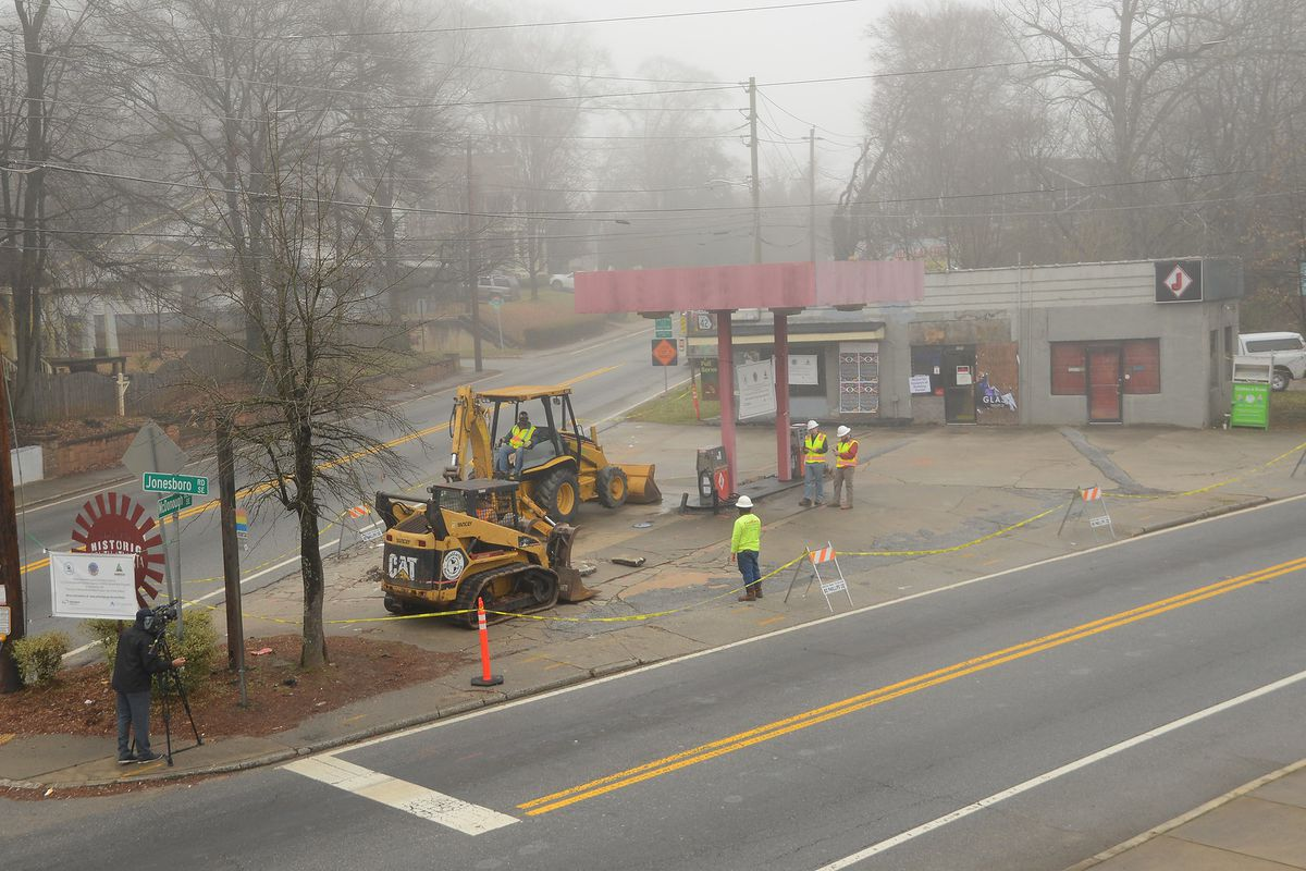 Bulldozers prepare to begin work on the site on a rainy morning.