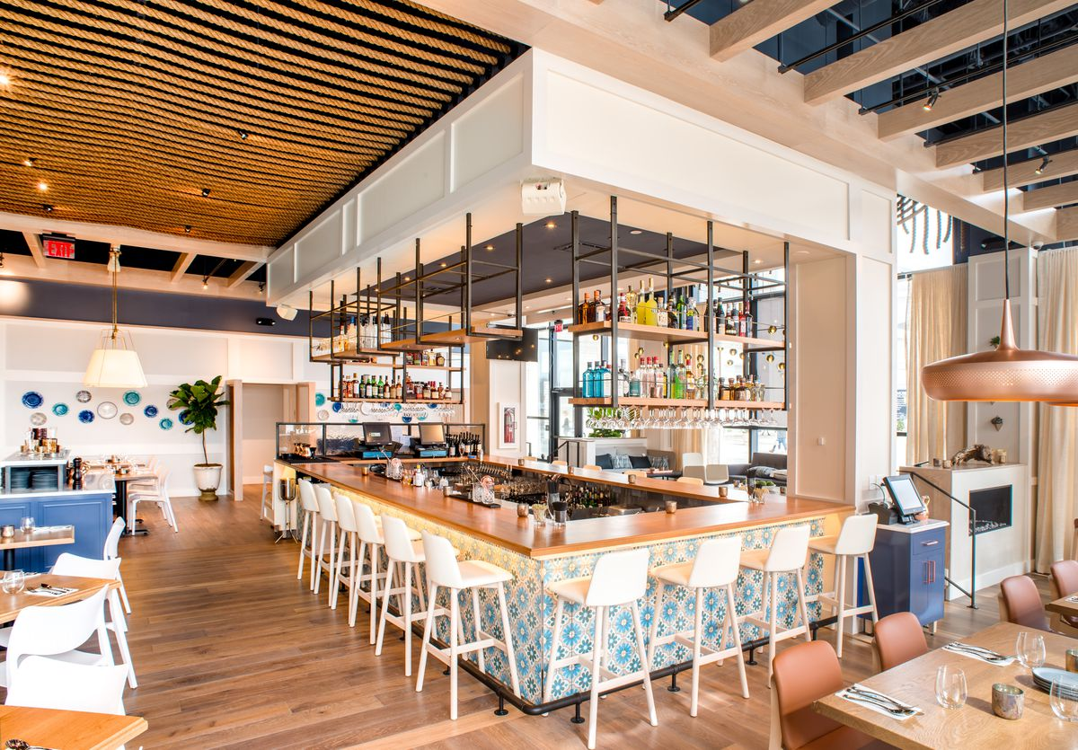 bright restaurant with stools around a bar