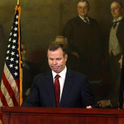 Embattled Utah Attorney General John Swallow grimaces after completing a press conference where he resigned as the state's attorney at the Capitol in Salt Lake City on Thursday, Nov. 21, 2013. Swallow cut a deal with the lieutenant governor's office to resign in order to avoid facing criminal charges. A report from the special counsel the office hired to investigate alleged election law violations recommended that Swallow be charged with three misdemeanors, a source said. In lieu of the criminal charges, the office negotiated a deal calling for only civil sanctions if Swallow would step down. The deal would prevent his election from being invalidated in a court action and his office from being up for grabs in a special election.