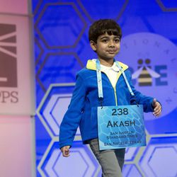 Akash Vukoti, 6, of San Angelo, Texas, walks to the microphone to spell a word, which he did incorrectly, during the preliminary round three of the Scripps National Spelling Bee in National Harbor, Maryland, on Wednesday, May 25, 2016. Akash was the youngest speller in this year's competition.