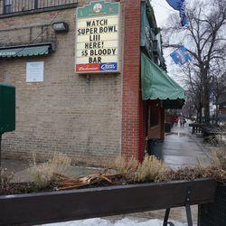 Snow almost gone on Sheffield Avenue, in front of Murphy's Bleachers