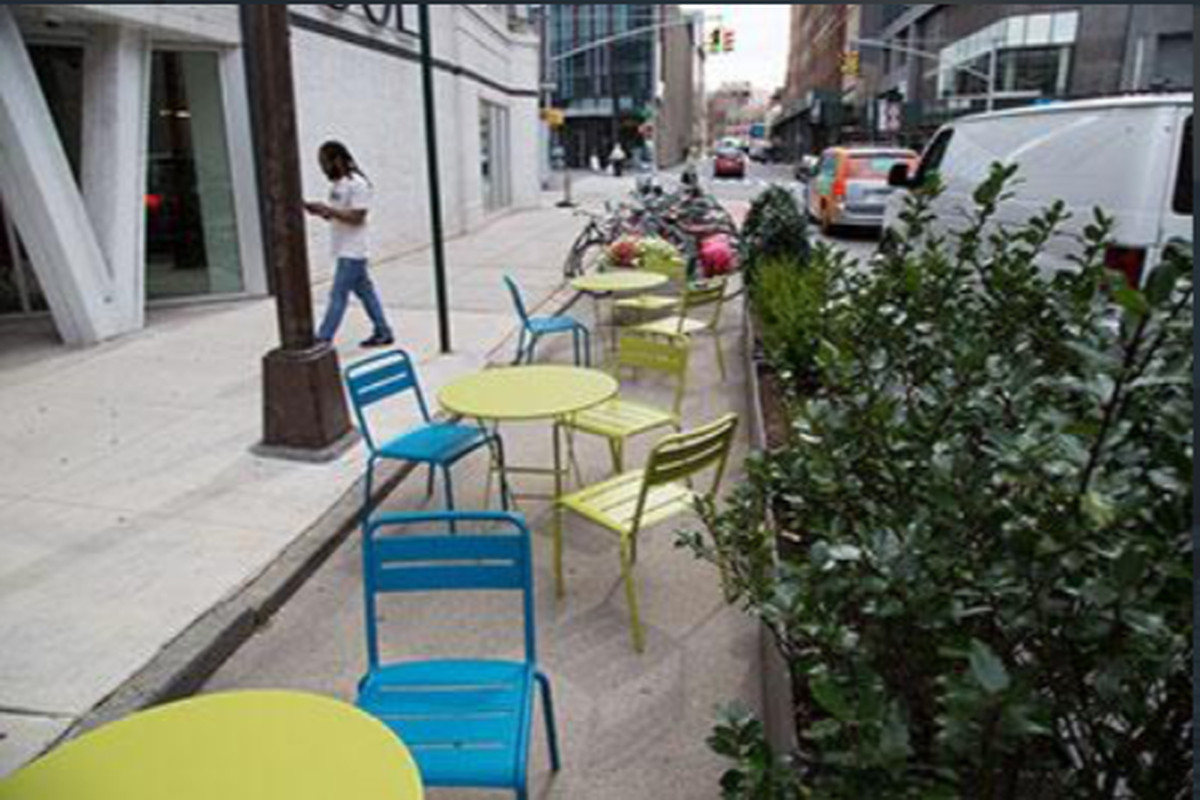 A street parking space with outdoor dining.