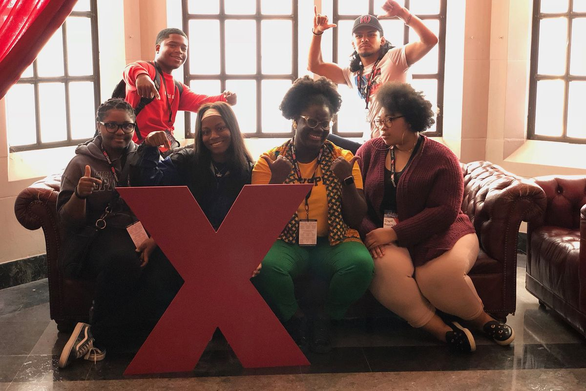 Joy Mohammed with a group of Western International High School students at TEDxDetroit at the Masonic Temple.