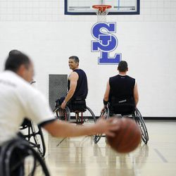 Jeff Griffin watches as the ball is brought up court during practice with his teammates at Salt Lake Community College's Lifetime Activities Center on Feb. 20.