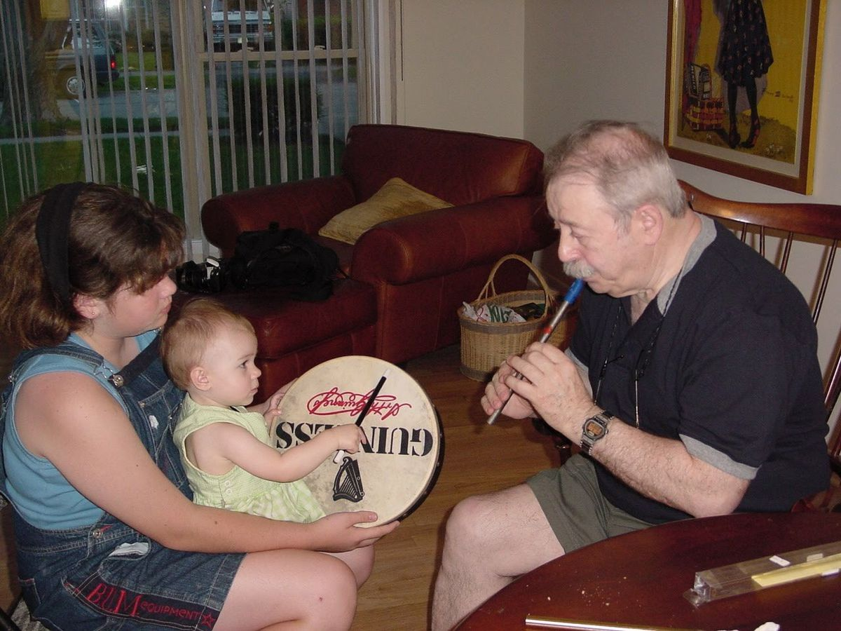 Irish music instructor Noel Rice (right) with granddaughter Patricia Halliburton holding another grandchild, Eileen Rice, with a traditional bodhran drum. | Provided photo